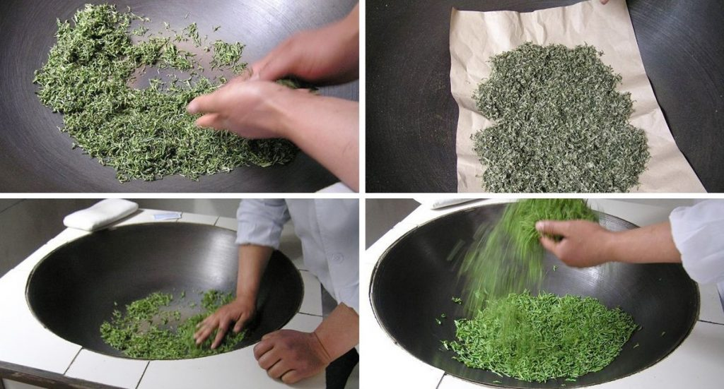 Traditional green tea rolling in the wok pan